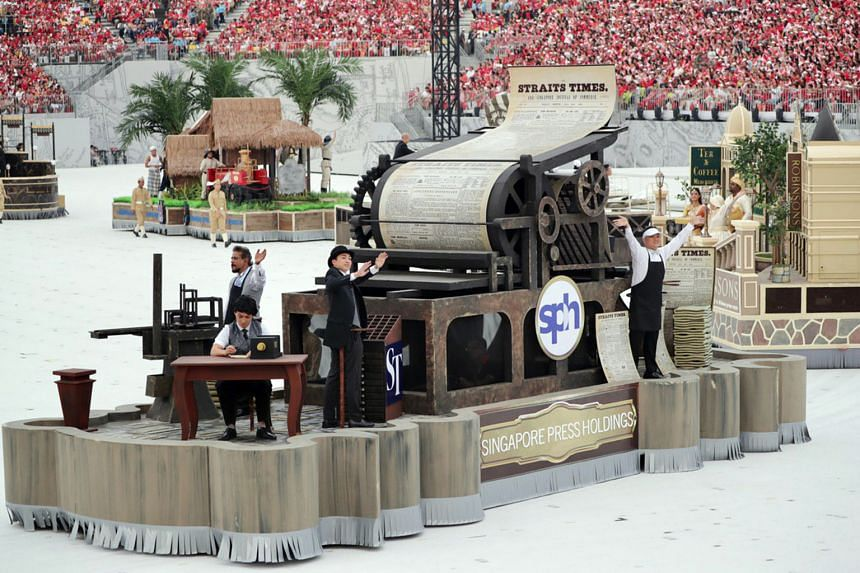 The Straits Times' bicentennial float featured a printing press used in the 19th century, with the first-ever edition of The Straits Times, published in 1845, being rolled out.