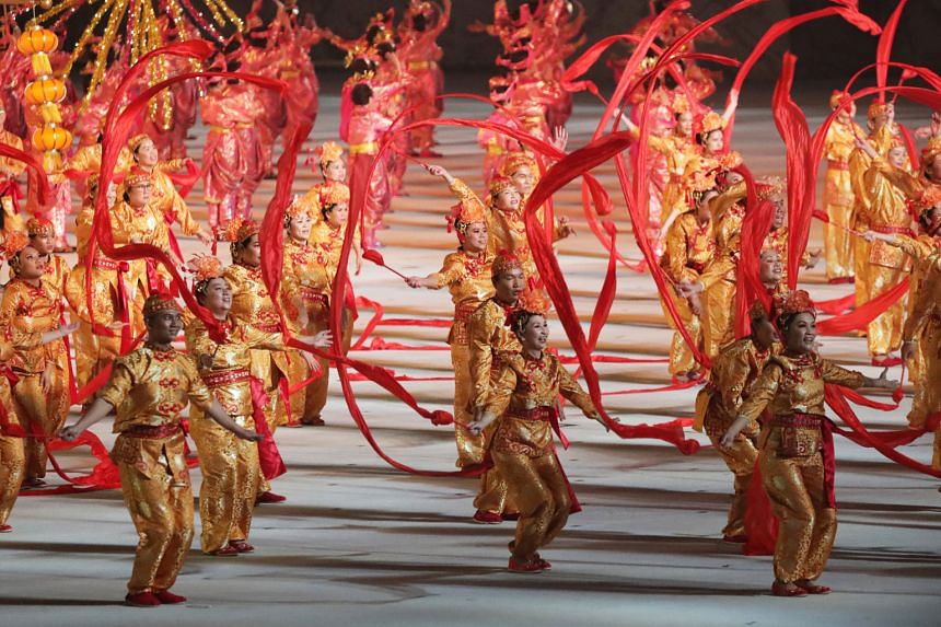 Dancers representing the Chinese in a multicultural dance segment. There were 380 dancers from the People's Association and 40 from the Music and Drama Company of the Singapore Armed Forces. Their performance was greeted with loud applause by the cro