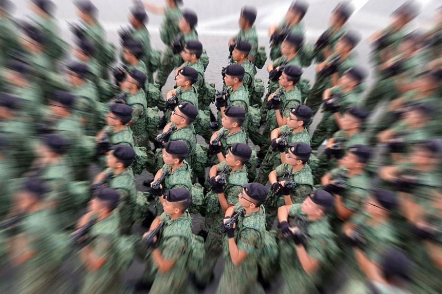 A contingent from the Singapore Armed Forces marching at the parade. This photo was captured using the Live Focus mode with Zoom effect.