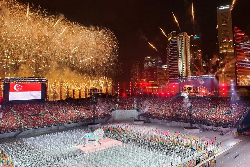A stunning fireworks display during the grand finale of the parade at the Padang yesterday. This year's fireworks were set off from three locations, including the Singapore River for the first time in parade history. This photo was captured on the Sa
