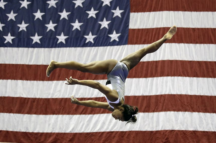 Simone Biles working on the balance beam during practice for the American gymnastics championships on Wednesday in Kansas City. PHOTO: ASSOCIATED PRESS
