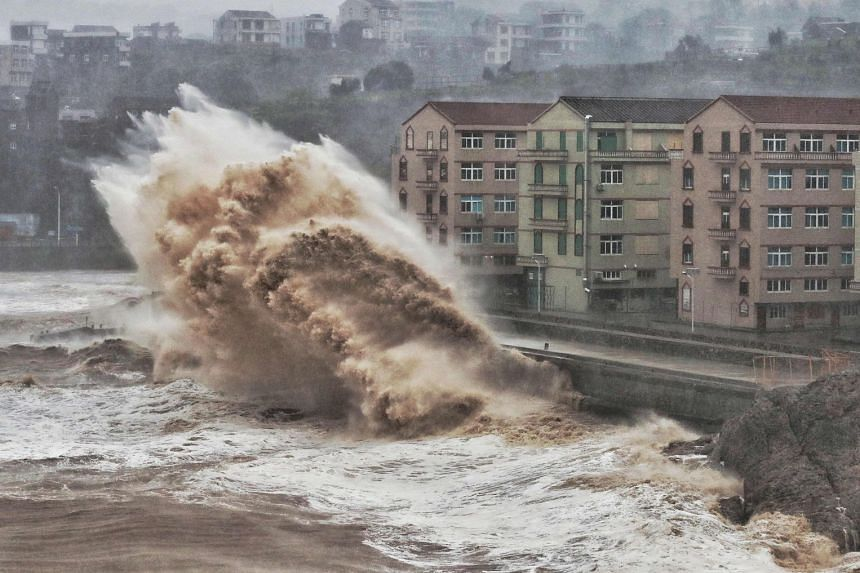 Above: Waves crashing against a sea wall in Taizhou, Zhejiang province, yesterday. Typhoon Lekima is expected to hit the Chinese province today, and possibly veer north towards Shanghai.