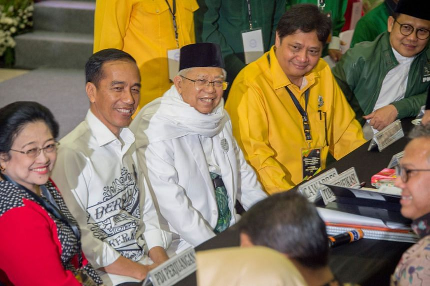 A file photo of Mrs Megawati Soekarnoputri with (from left) Indonesia's President Joko Widodo, his running mate Ma'ruf Amin and coalition party leaders at the election commission office in Jakarta last year. Mrs Megawati's PDI-P had backed the re-ele