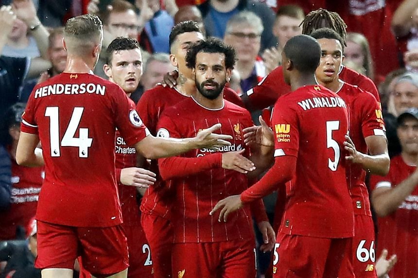 Liverpool's Mohamed Salah (centre) celebrates scoring his side's second goal with team mates.