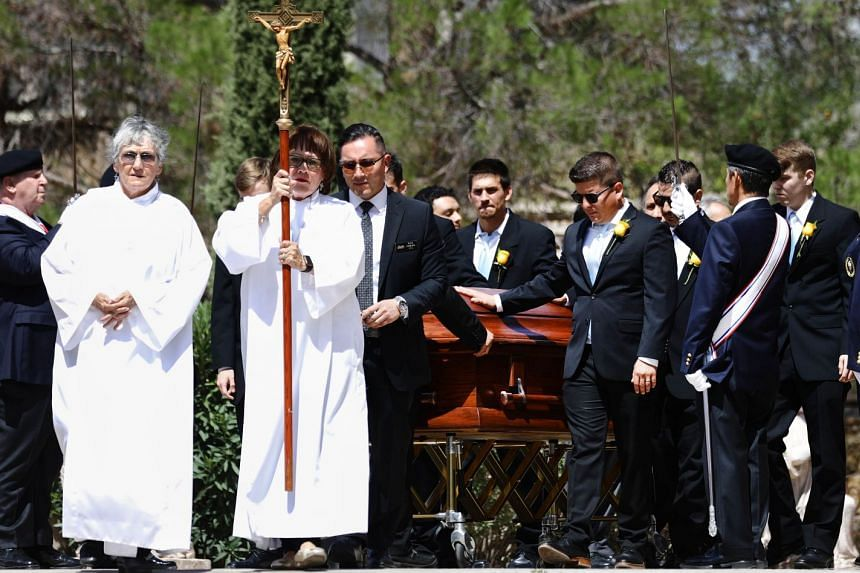 Pallbearers wheel the casket of Angelina Englisbee, 86, who lost her life in the El Paso mass shooting.