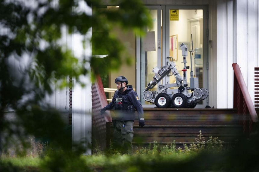 A police officer with a robot at the svene of the shooting, the Al-Noor Islamic Centre mosque.