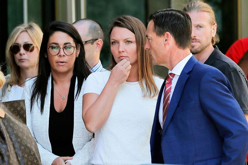 Alleged victim Courtney Wild (centre) stands outside court ahead of a bail hearing for Epstein in July 2019.