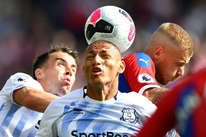 Everton's Richarlison and Seamus Coleman in action with Crystal Palace's Max Meyer.