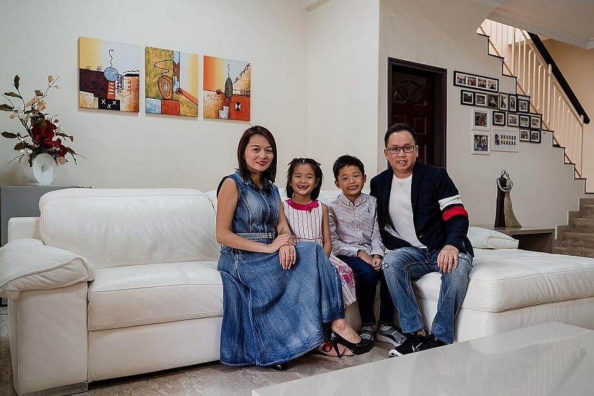 Property company executive Kevin Seetoh, his wife Agnes Tiew and their son, Eldon, eight, and daughter, Charmaine, seven, in their rented home in Katong. Mr Seetoh intends to sell his existing residential property and buy two smaller such assets so as to
