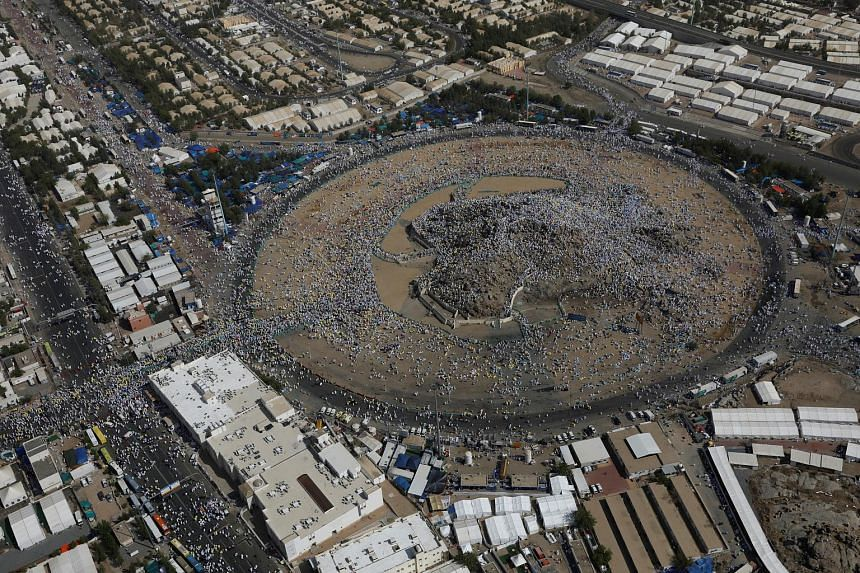 Muslim pilgrims gathered on the Mount of Mercy on the plains of Arafat during the haj pilgrimage, outside the holy city of Mecca in Saudi Arabia yesterday. Some pilgrims spent the night in a sprawling encampment around the hill, while others ascended