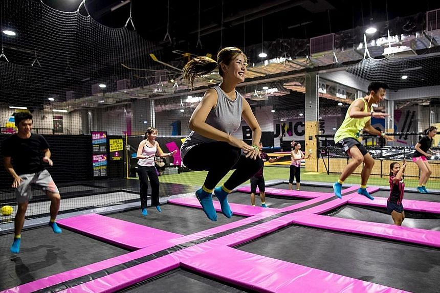 Bounce Fit participants jumping on trampolines during a class. PHOTO: BOUNCE SINGAPORE