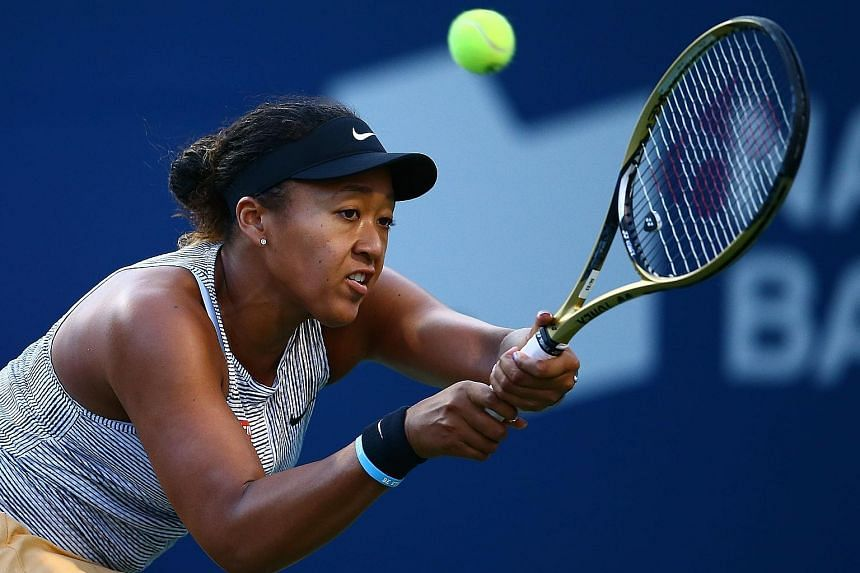 Naomi Osaka hits a return against Serena Williams during their Rogers Cup quarter-final on Friday. The Japanese had no answers to her opponent's 31 winners, however, as the American won in straight sets. PHOTO: AGENCE FRANCE-PRESSE