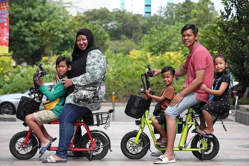 Madam Juraidah Zakaria and Mr Youzimanto Onan with their children (from far left) Shahyul Yushi, Shamierul Ariq and Syazie Ayiesha. The longest ride the family has taken was a 50km round trip around Singapore, where they covered areas such as Bukit B