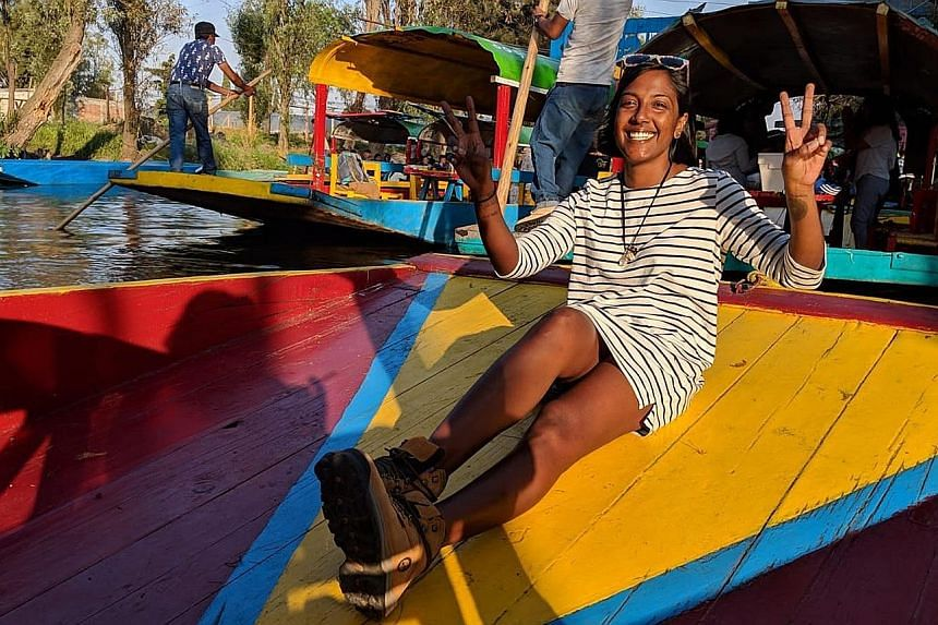 Digital nomad Crunch Ranjani Rajandran (left, in a photo taken in Xochimilco, Mexico) has a flexible writing career that takes her around the world. She can return to Singapore when she needs to, such as to take care of her mother.