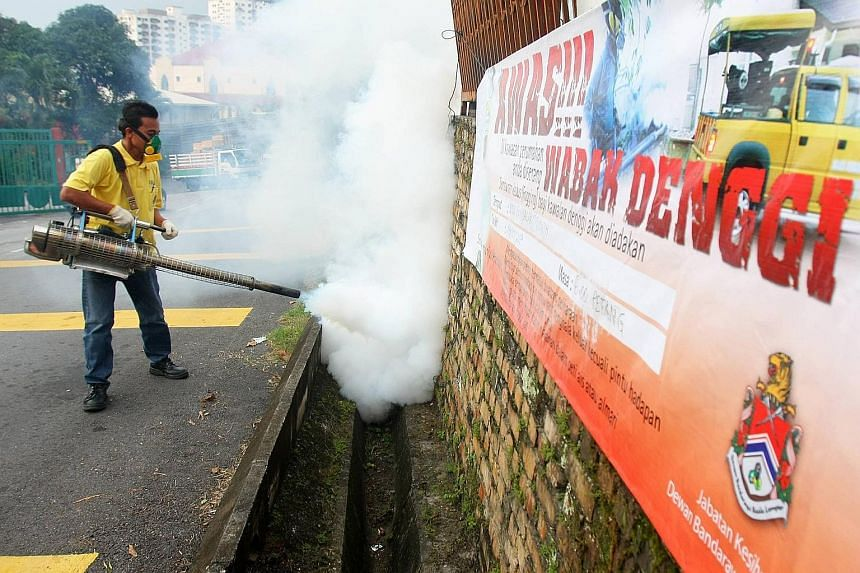 Fogging being carried out in Kuala Lumpur. There were 251 dengue hot spots in nine states in Malaysia, and most cases were in urban areas. PHOTO: THE STAR/ASIA NEWS NETWORK