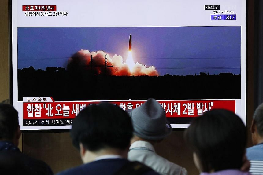 A news broadcast in Seoul on North Korea's missile launch yesterday. The projectiles were fired at dawn from an area around the city of Hamhung, said South Korea's Joint Chiefs of Staff. PHOTO: EPA-EFE