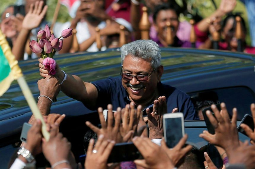 In a photo taken on April 12, Sri Lanka's former defense secretary Gotabaya Rajapaksa greets his supporters after his return from the United States, in Katunayake, Sri Lanka.