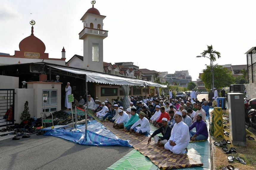 Congregants praying in and outside the Abdul Razak Mosque as they come together for a Hari Raya congregational prayer on Aug 11, 2019.