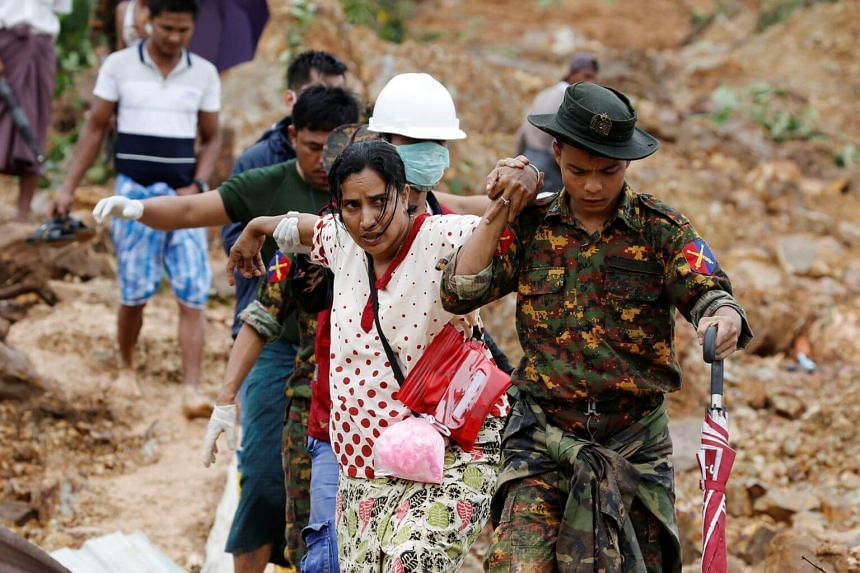 Soldiers and rescue workers assisting residents following a landslide in Mottama in Myanmar's Mon state, on Aug 10, 2019.