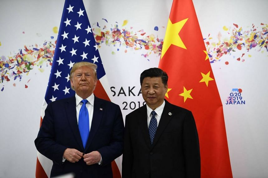 US President Donald Trump (left) and Chinese President Xi Jinping attending a bilateral meeting on the sidelines of the G20 Summit in Osaka, on June 29, 2019.