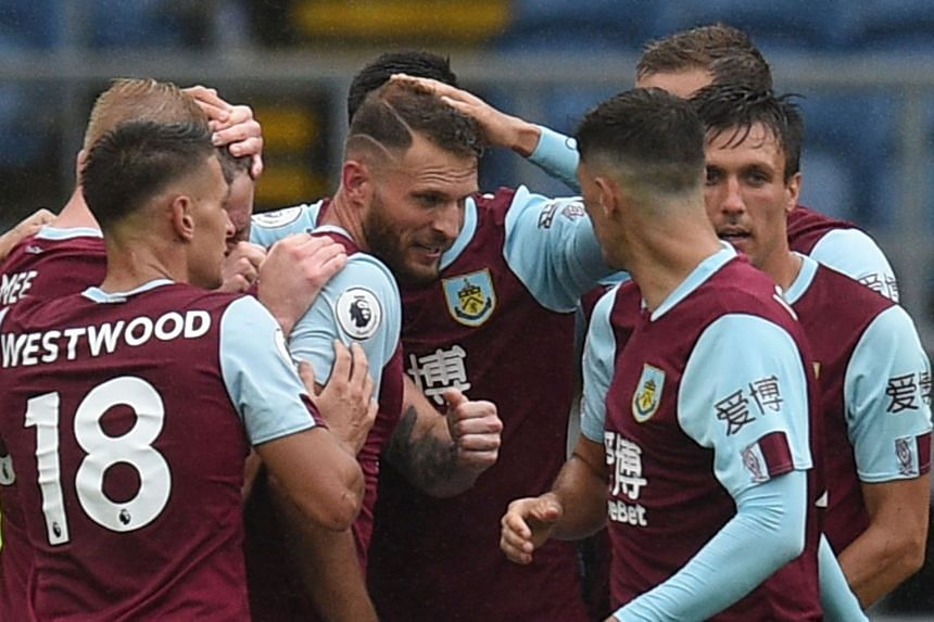 Burnley's Ashley Barnes (centre) celebrates scoring their second goal with team mates.