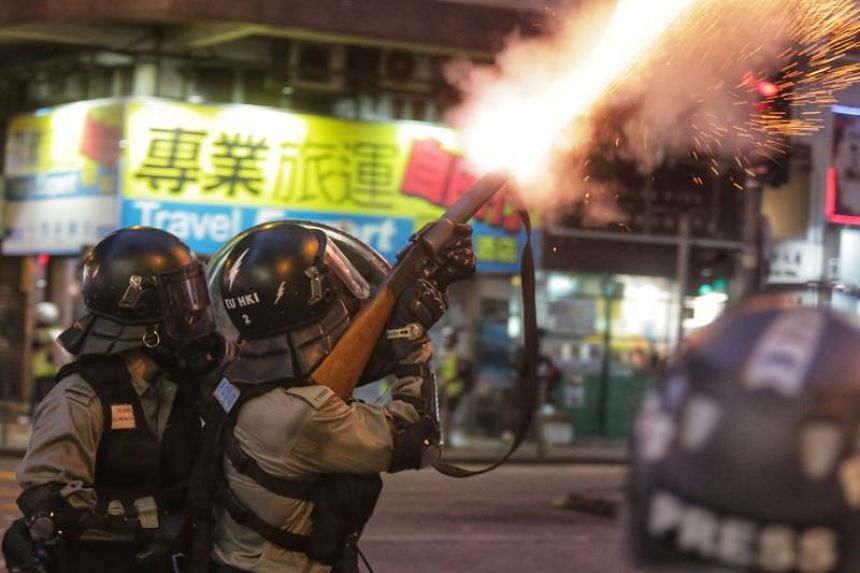 Hong Kong police fire tear gas towards protesters during in Hong Kong's Wan Chai district on Aug 11, 2019.