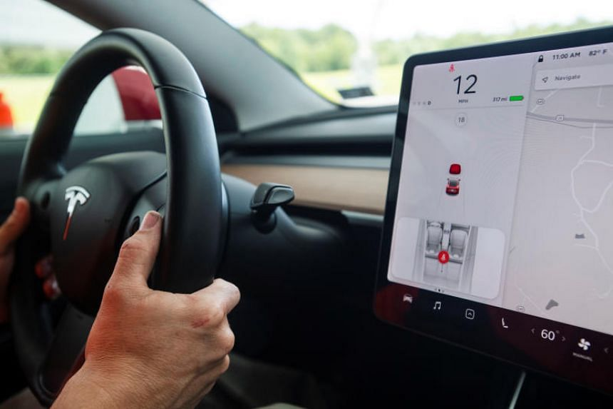 A demonstration of a front crash prevention test on a 2018 Tesla Model 3 at the IIHS-HLDI Vehicle Research Center in Ruckersville, Virginia, on July 22, 2019.