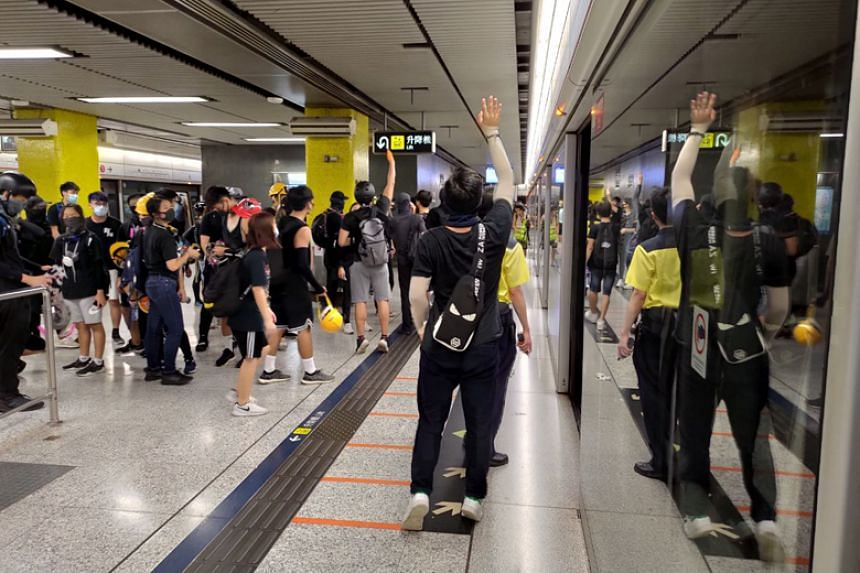 Protesters streaming into Tsim Sha Tsui MTR station after tear gas was fired during a rally in the district on Aug 11, 2019.