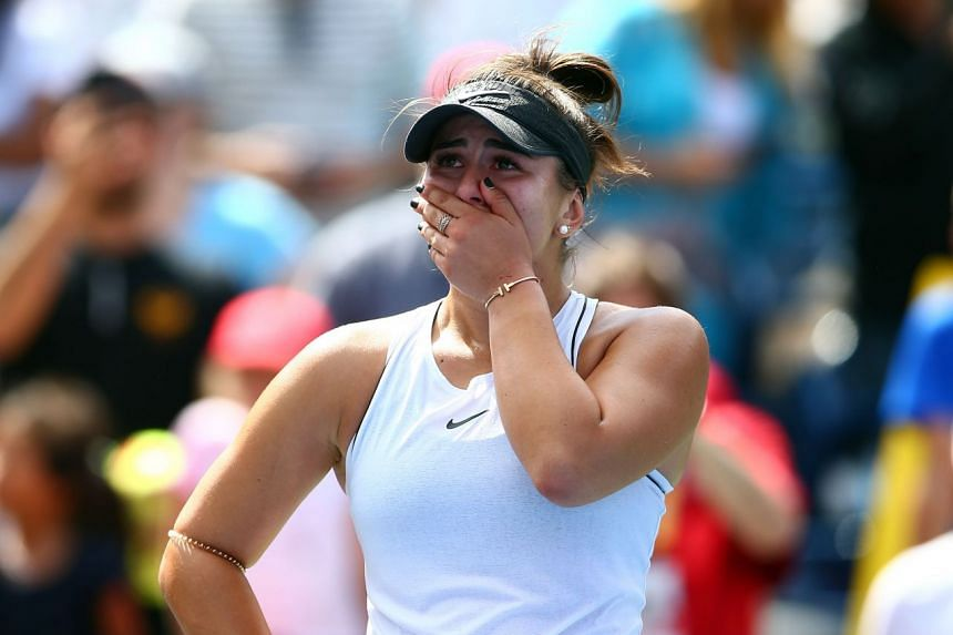 Andreescu reacts after defeating Sofia Kenin of the United States.