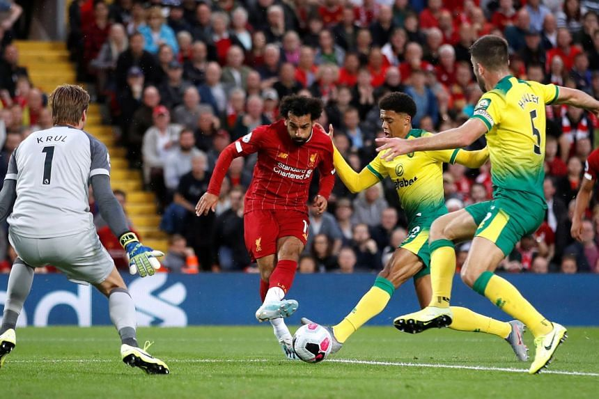 Mohamed Salah slotting home Liverpool's second goal against Norwich at Anfield. The Reds won 4-1.