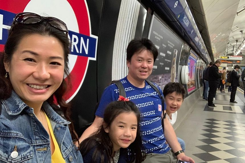 Dr Faye Lim (with her daughter Elena, husband Chan Jin Hoe and son Alisdair in London during the school holidays in June this year) came back to Singapore for her children.