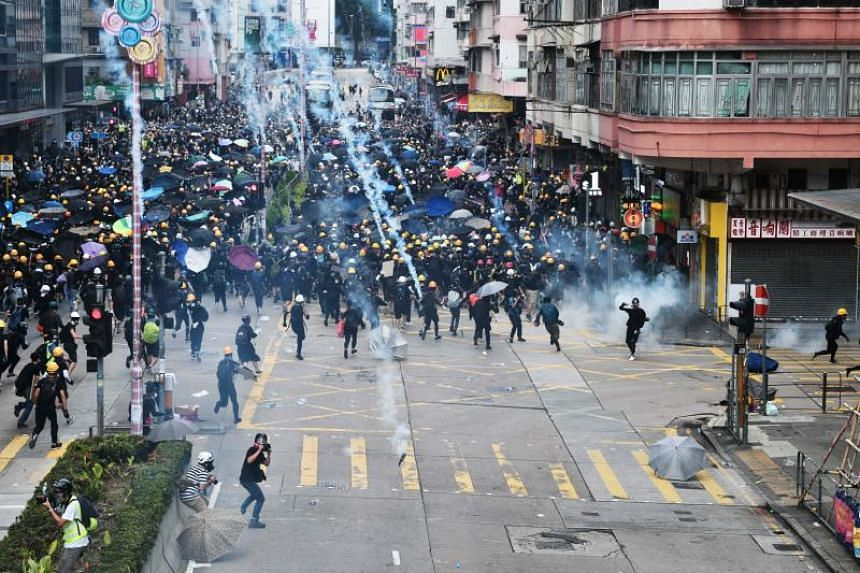 Hong Kong police fire tear gas at protesters in Hong Kong's Sham Shui Po district on Aug 11, 2019.