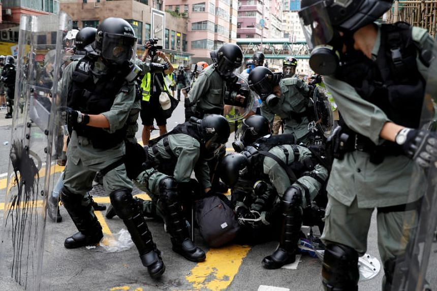 A protester being detained during a march in Hong Kong's Sham Shui Po district on Aug 11, 2019.