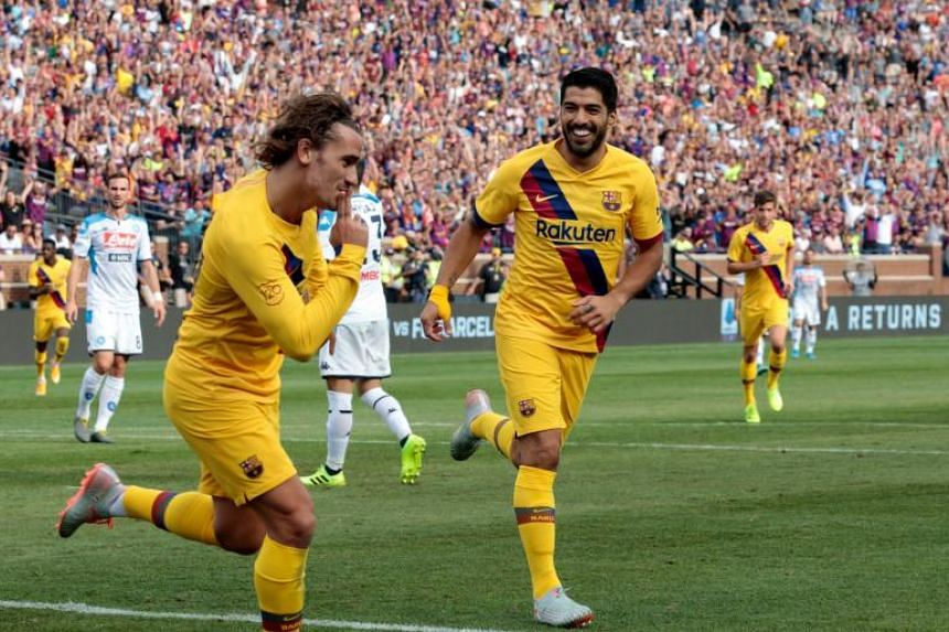Barcelona's Luis Suarez (right) celebrates his goal with teammate Antoine Griezmann during the second half of the La Liga-Serie A Cup match against Napoli at Michigan Stadium on Aug 10, 2019.