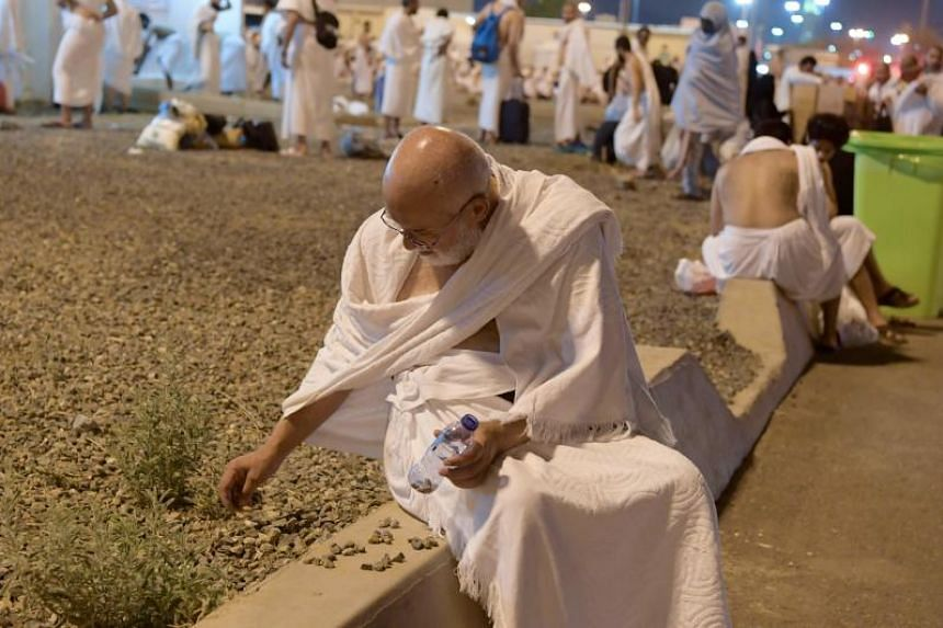 A Muslim pilgrim collects pebbles at Muzdalifah near the holy city of Mecca on Aug 10, 2019, to be used in the ritual of stoning the devil in Mina.