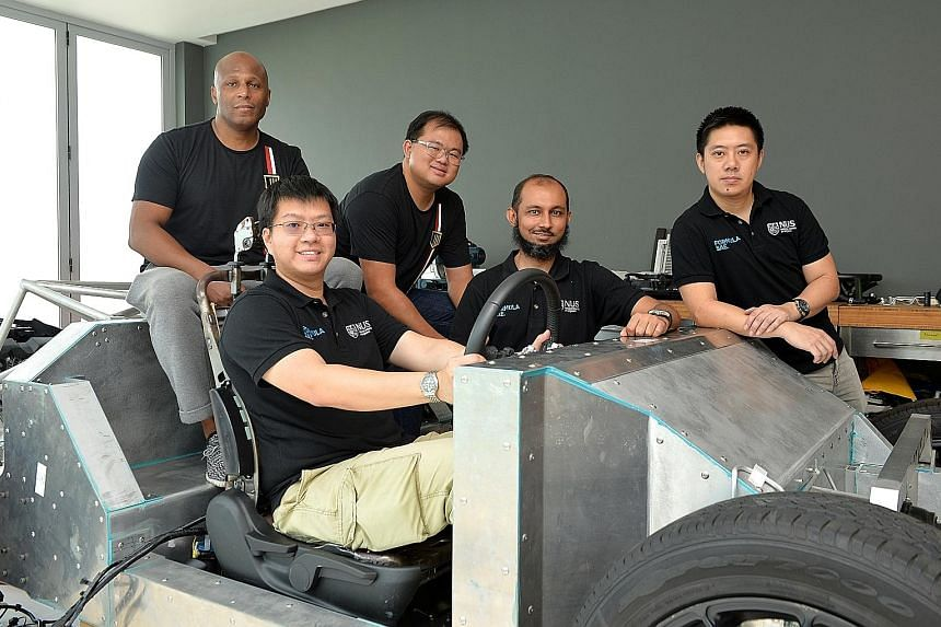 (From left) Catalyst Motors co-founder Anthony Parks, NUS engineer Kenneth Neo Kang Wei, Catalyst Motors design engineer Lim Chin Khiong, and NUS engineers Hozefa Husainee and Lim Hong Wee with the rolling chassis that the firm will use for its proto