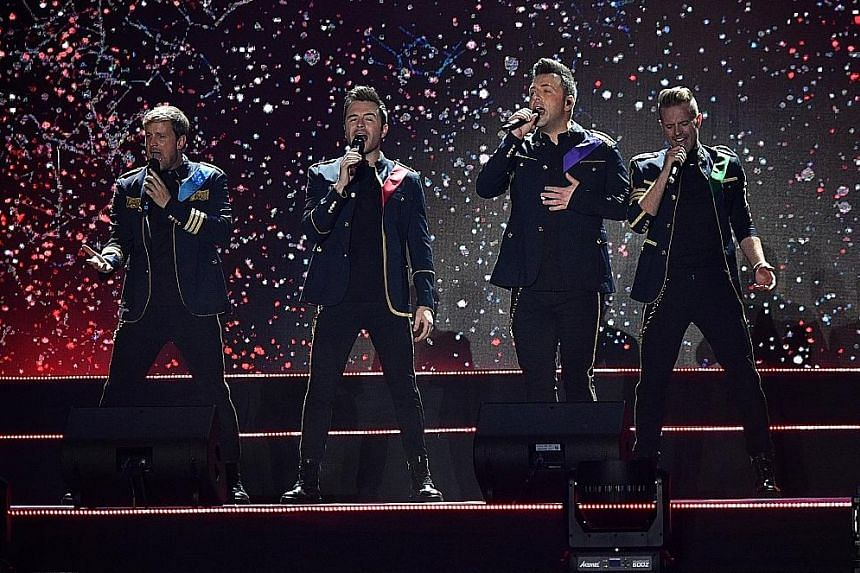 Westlife (comprising from left, Kian Egan, Shane Filan, Mark Feehily and Nicky Byrne) relied heavily on their catalogue of greatest hits.