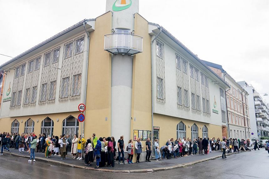 People showing their solidarity with the al-Noor Islamic Centre by standing outside the Norwegian mosque yesterday, a day after a gun attack at the place of worship. The police said the suspected attacker - a young, white male carrying several guns -