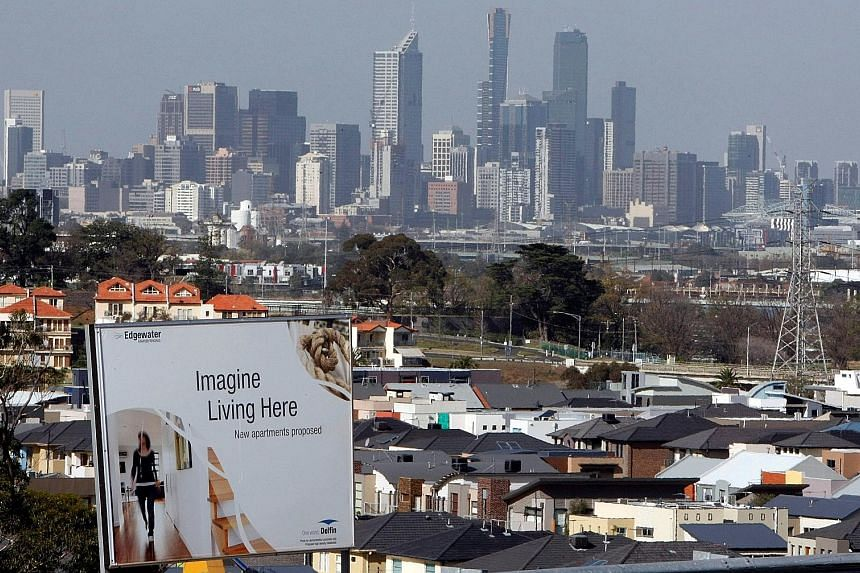 A billboard for a housing project, with the Melbourne skyline in the distance. Despite stable price rises last month, property values across Australia have plunged since their peak about two years ago.