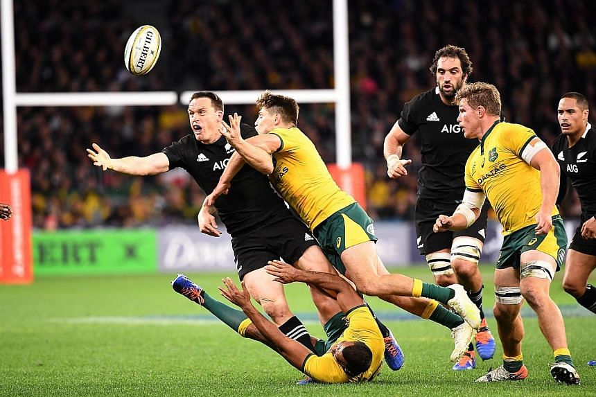 James O'Connor of the Wallabies tackling the All Blacks' Ben Smith during the Bledisloe Cup match in Perth on Saturday. New Zealand lost 47-26 but will have a chance for revenge in the return match in Auckland this Saturday. PHOTO: EPA-EFE
