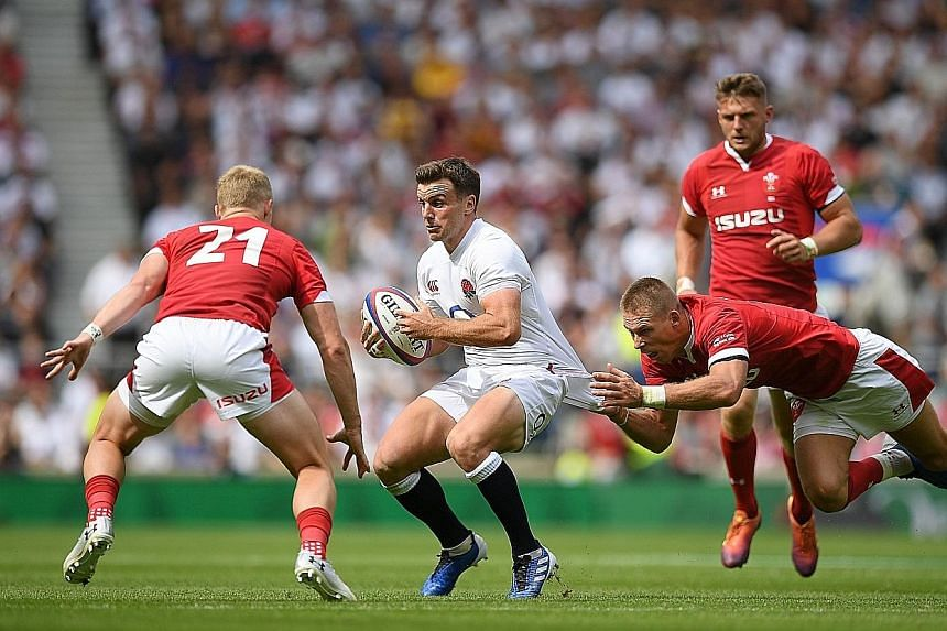 England fly-half George Ford is tackled by Wales full-back Liam Williams (right) during their Test match at Twickenham. The two sides will face each other again as part of their warm-up matches for the Rugby World Cup.