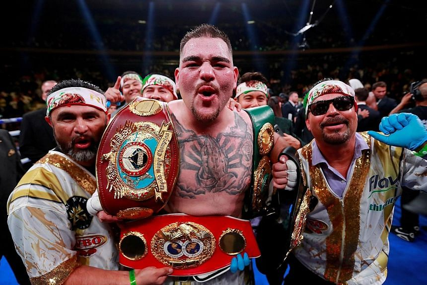 American heavyweight boxer Andy Ruiz Jr celebrating with the belts after defeating Briton Anthony Joshua in their fight at Madison Square Garden in New York in June.