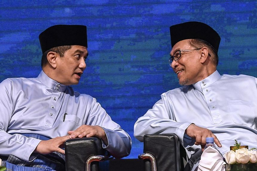 In this photo taken on Sept 1 last year, Parti Keadilan Rakyat chief Anwar Ibrahim (right) is seen chatting with Economic Affairs Minister Azmin Ali at the Future of the Bumiputera and Nation Congress held in Kuala Lumpur.