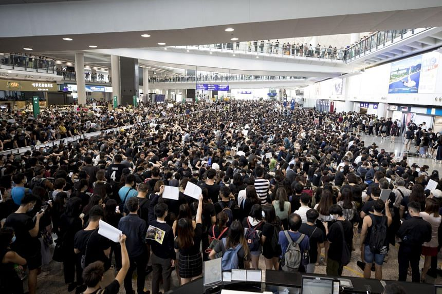 Protesters demonstrate at the airport in Hong Kong on Aug 12, 2019.