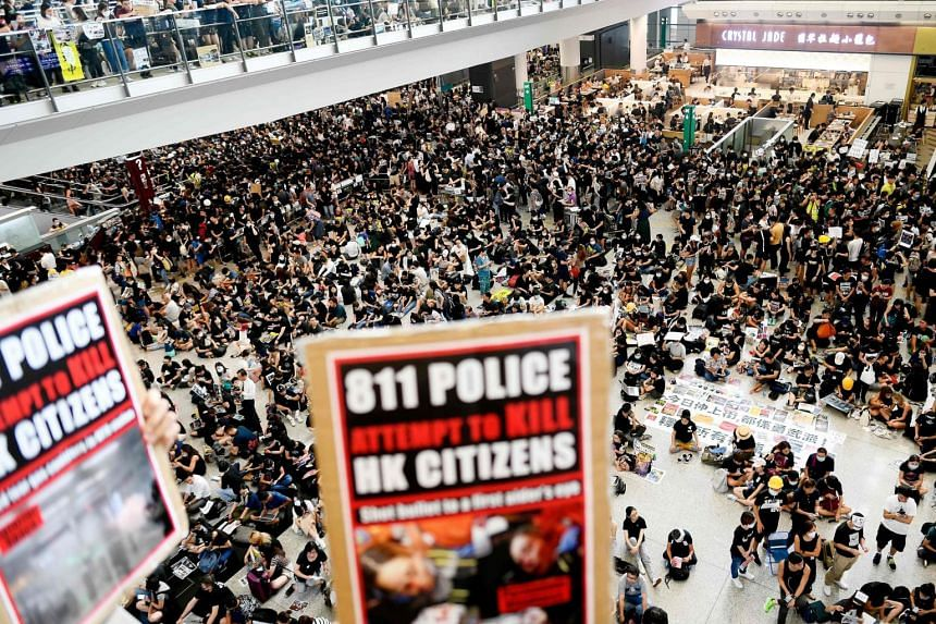 Pro-democracy protesters gather against the police brutality and the controversial extradition bill at Hong Kong's international airport on Aug 12, 2019.