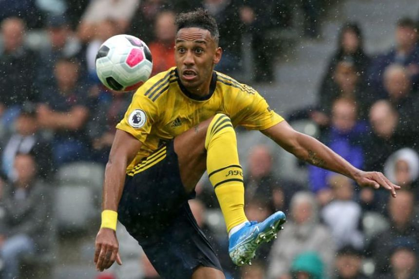 Arsenal's Gabonese striker Pierre-Emerick Aubameyang controls the ball during the English Premier League football match between Newcastle United and Arsenal at St James' Park in Newcastle-upon-Tyne, north east England, on Aug 11, 2019.