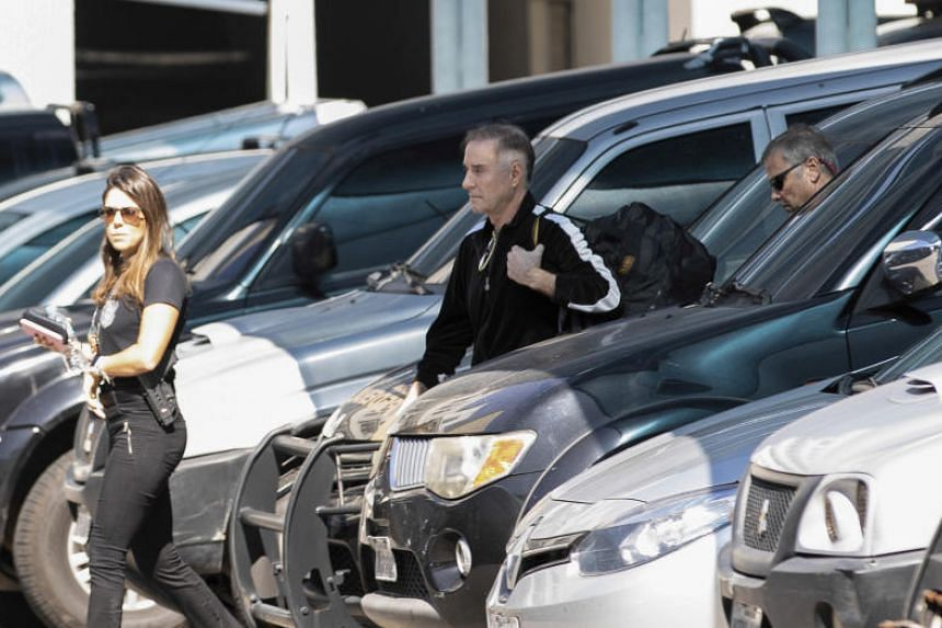 In this picture taken on Aug 8, 2019, Brazilian businessman Eike Batista (center) is escorted to a police station in Rio de Janeiro, Brazil.