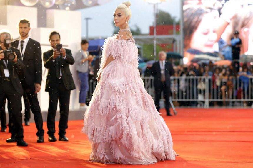 Grammy-winning singer Lady Gaga aims to bring a measure of hope to places devastated by an extraordinary week of mass shootings in a country numbed by a steady beat of news about gun violence.