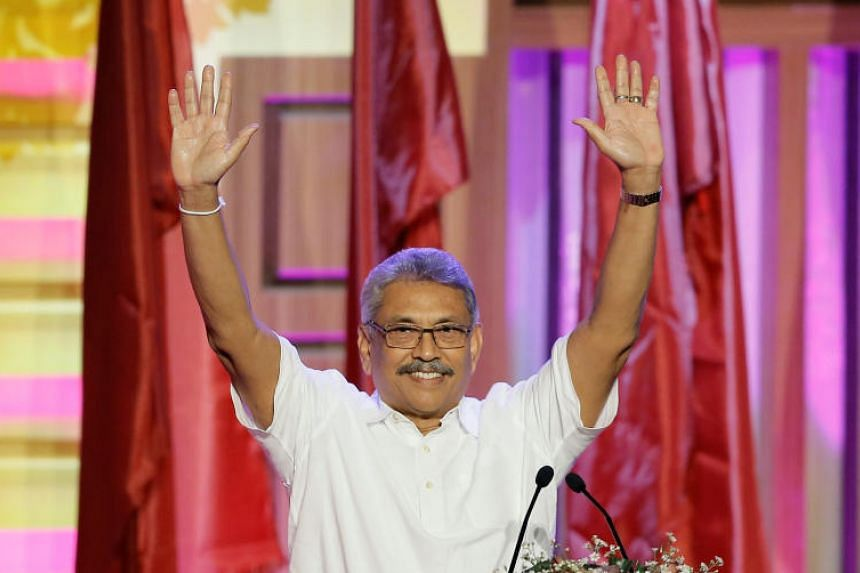 Sri Lanka's former defence secretary Gotabaya Rajapaksa waves after he was nominated as a presidential candidate during the Sri Lanka People's Front party convention in Colombo, Sri Lanka, on Aug 11, 2019.