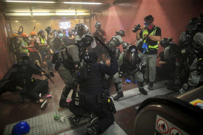Policemen charge and arrest protesters inside the Tai Koo MTR station during the anti-extradition bill protest in Hong Kong, on Aug 11, 2019.